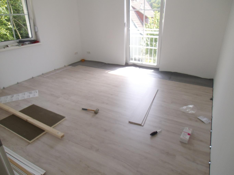 laminat wir bauen mit town und country in oberursel. Black Bedroom Furniture Sets. Home Design Ideas